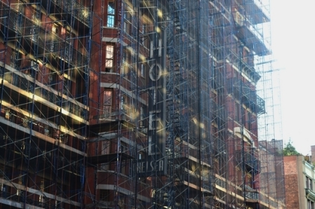 Behind the scaffolding, the old sign for the Hotel Chelsea on West 23rd Street is still visible. Photo: Liz Hardaway