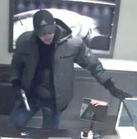 Gunman robs $700K in watches